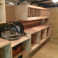Woodworking Miter Saw The hidden location of the vac system that is attached to the miter saw and table saw. Trailer Shelving, Van Shelving, Trailer Storage, Desk Shelves, Workshop Layout, Workshop Storage, Garage Workshop, Van Storage, Garage Storage