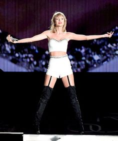 Taylor Swift slayed the stage at Heinz Field in Pittsburgh, Pa. on June 6, wearing a white bustier, high waisted white shorts, and a pair of black, thigh high boots.