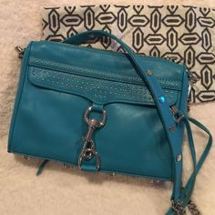 Rebecca Minkoff mini Mac- NWT Rebecca Minkoff mini mac- NWT. Comes with dustbag and extra leather piece. Color is teal. Silver hardware. Just gorgeous! 🎉HP: Best in Bags 6/26/16🎉 Rebecca Minkoff Bags Crossbody Bags