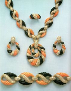 Boucheron Necklace, Earrings, Bracelet, and Ring of coral, onyx, and diamonds (=)