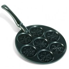 Gear up for a snowy day of fun with the NordicWare Snowflakes Pancake Pan, available at the Food Network Store
