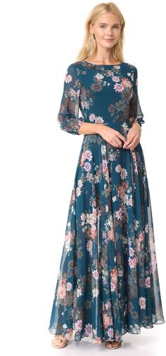 This Yumi Kim maxi dress is detailed with a wildflower print. The fitted bodice flows into a loose, floor-length skirt. 3/4 sleeves with elastic cuffs. Hidden back zip. Lined.