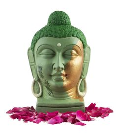 This Buddha head with a serene and peaceful meditating expression will surely provide a tranquil tone to your place. It is intricately and diligently handcrafted by the artisans. The green and golden paints are used artistically to give it a unique yet majestic touch. Delicately painted lotus flowers on the side of the face gives it an astounding look. It would surely add to the beauty and uniqueness of your house.