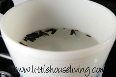 Creating a Moth Trap - In a bowl, add in dishsoap while you are filling it with water so the soap foams up. You only need a few inches of water. Place the bowl under a light e.g. on the stove and turn the stove light on above it. Turn off all other lights in the area. In the morning, hopefully you'll see what's in the photo! No chemical sprays used and easy to set up but it works!