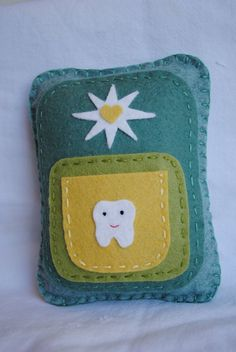 love this. I would just sew a handle on it to hang on the doorknob. At our house the tooth fairy needs a reminder occasionally. :)
