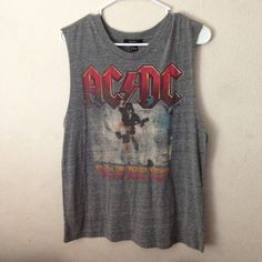 ACDC Tank/Muscle Shirt Low Scoop Sides An ACDC shirt that can be worn in any way. A must have that will edge your look out. Forever 21 Tops Muscle Tees