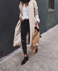 tan jacket, white linen shirt, black jeans and booties