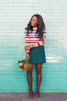 London Blogger and knitwear affectionado @iamkristabel wears our cashmere crew neck jumper with a green mini skirt for a colourful Autumn look. Shop our Annabel moleskin A-line skirt by clicking the image.
