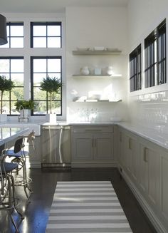 gorgeous black window and white wall/tile contrast in this kitchen of grey