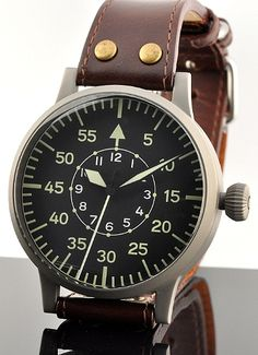 LACO FLIEGER Pilot's watch. This is a very neat reproduction of a WWII pilots watch. It measures out to a massive 55mm which is big, indeed. It a cool modern watch.
