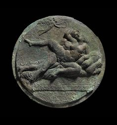 Mirror Cover with Eros and erotic scene (symplegma).  Greek. Late Classical or Early Hellenistic Period, about 340–320 B.C. Place of Manufacture: Corinth, Corinthia, Greece.