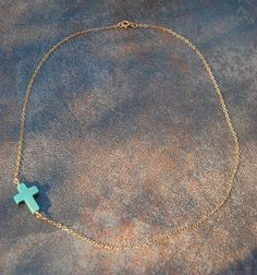 turquoise sideways cross