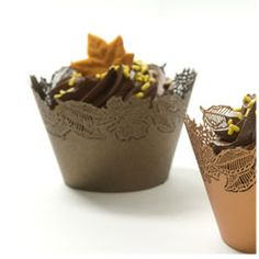 Fantastic autumn metallic leaf cut-out cupcake liners, and sweet little autumn leaf and skeleton leave decorations.