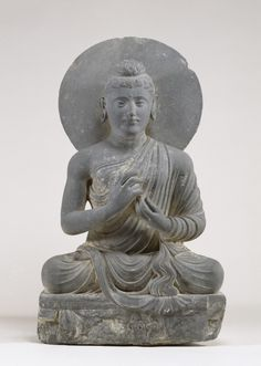 An ancient Gandharan figure of Buddha making the dharma-chakra mudra. (Walters Museum)