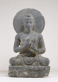An ancient Gandharan figure of Buddha making the dharma-chakra mudra. (Walters Museum)