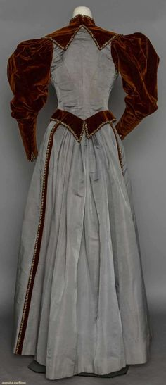 Afternoon gown, grey silk twill and rust velvet, trimed with narrow bands of gold & blue beads, 1895, from the Suddon-Cleaver Costume Collection