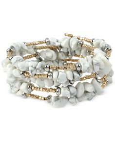 "Get your earth-loving vibe on with this edgy white stone chip coil bracelet designed by Kenneth Cole New York with gold-tone and silver-tone mixed metal detailing. Approximate diameter: 2-1/3"". 