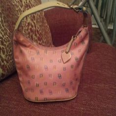 Pink dooney Bourke hobo bag This has and adjustable strap and in great condition Dooney & Bourke Bags Hobos