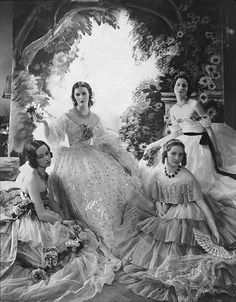 The Famous Beauties Ball, 1931.Miss Baba Beaton (second from left) surrounded by Jess Chattock, Nancy Mitford, and Carol Prickard in enormous pageant dresses. by Cecil Beaton