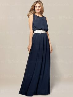 Sleeveless chiffon mother of the bride dress is an A-line gown with gathered illusion bateau neckline.