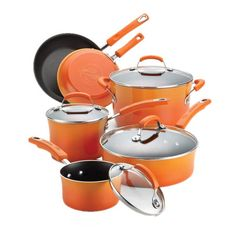 Essential for any home cook, this orange-hued cookware set features aluminum pots and pans to fit your every need. Product: 1...