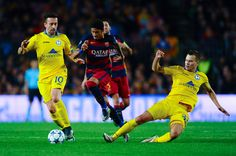 Neymar of FC Barcelona competes for the ball with Nemanja Nikolic (L) and Denis Polyakov of FC BATE Borisov during the UEFA Champions League Group E match between FC Barcelona and FC BATE Borisov at the Camp Nou on November 4, 2015 in Barcelona, Catalonia.