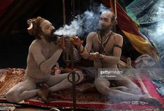 Sadhu (holy men) smoke during Kumbh Mela, the largest Hindu gathering in the world, February 11, 2010 in Haridwar, India. Hindus believe that bathing in the Ganges during the festival cleanses them of sin.