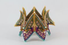Fortune teller colorful beaded bangle based on Kate McKinnon's work Kate Mckinnon, Jewelry Art, Beaded Jewelry, Beaded Bracelets, Handmade Jewelry, Baubles And Beads, Beaded Ornaments, Geometric Jewelry, Geometric 3d