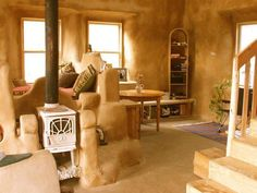 Houses made from Cob stay naturally cool in the summer and warm in the winter. Cob is fireproof, resistant to seismic activity, and inexpensive. Cob is made out of clay, sand, straw, water, and earth - a totally natural and sustainable building material.