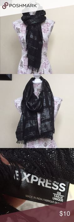 Express black & silver shimmery scarf Love this scarf.  Perfect to jazz up your outfit with a touch of shimmer.  It has some snags here or there but nothing major.  Great addition to your accessories collection 😍 Express Accessories Scarves & Wraps