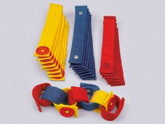 Loop & Learn Fine Motor Bands- buttoning activity alternative: can make with felt strips and buttons!