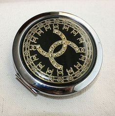 Vintage Chanell compact mirror with etched and goldtone design