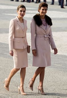 Queen Letizia (L) and Argentina's first lady Juliana Awada walk during the welcoming ceremony at Royal Palace in Madrid