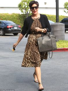 Kris Jenner rocking a cool leopard print dress and black cover. Also with a unique gorgeous purse