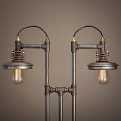 With a bit of steam-punk inspirations, this lamp is made of found items such as iron pipe fittings secured into a wooden base, brass wire fittings, toggle switch on base, and re-purposed hubcaps that serve as reflectors.