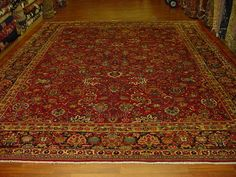 Beautiful antique Persian Sarouk, central Persia, size 10 ft by 13 ft. 6 inches,circa 1930 with lovey colors, all over design, deragons and could-bands in excellent condition.