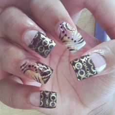 OMG !  My favorite Coach on nails !
