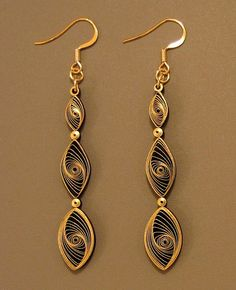 Create absolutely stunning jewelry with quilling paper. These Quilled Gilded Earrings are gorgeous paper jewelry pieces. Learn how to make earrings in a new way with this beautiful paper craft.