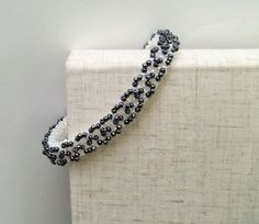 White Pearl and Hematite Cubic Right Angle by RachelNicoleDesigns, $18.00