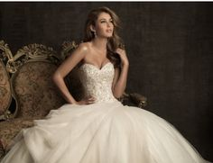 Sleeveless white wedding dress with sweetheart necklace and beaded bodice. Princess silhouette.