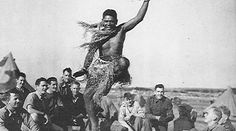 Image : Victor Blanco dancing traditionally with his soldier friends