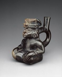 Seated Figure Bottle  Date:     2nd–5th century Geography:     Peru Culture:     Moche Medium:     Ceramic
