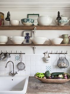 open wood shelving really stands out against the white wall!