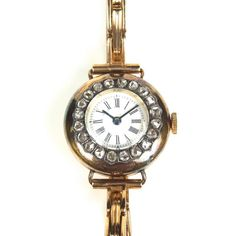 9 ct yellow gold diamond cocktail watch. 9 ct yellow gold diamond cocktail watch. The rose cut diamond set 23 mm round case with enamelled dial, blued hour and minute hands, Roman numerals and outer one minute track, to a sprung link bracelet. Manual wind movement. Total estimated diamond weight 1.20 cts. Weight 21 grams. Currently in working order, however, Grand Auctions does not guarantee the working order or accuracy of any watches sold.