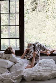 Reading something by the window. This looks so relaxing...