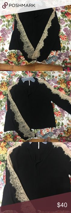 Free People Black Blouse with lace detail sleeves Never worn Free People Black Blouse with cream Lace detail sleeves and neck tie Free People Tops Blouses