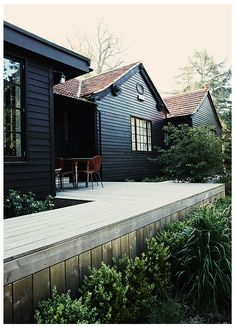 Black Clapboard Weathered Wood Deck In A Clean Design Dark House Siding