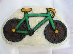 Bike Birthday Cake I made for my husband! Carrot Cake with walnuts and Cream Cheese Frosting. I baked it in a bike shaped mold and traced the outline using the cream cheese frosting that I dyed with food coloring.