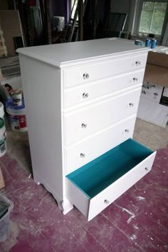 love the idea, I'm thinking of doing it with a black dresser (or painted black, hehe) and doing a purple on the inside! (would match our bedroom perfectly)