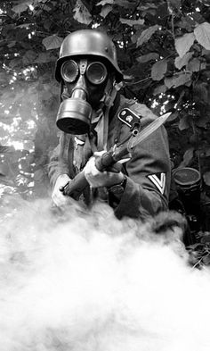 A German soldier with a gas mask. What happens if you sneeze?